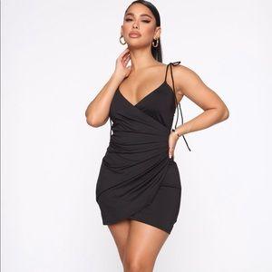 Tell the truth mini black dress